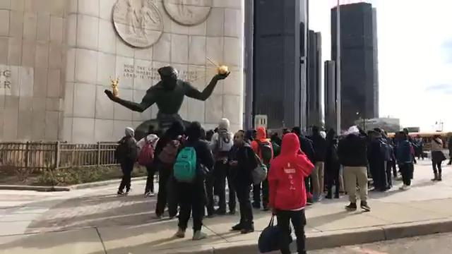 Students from Martin Luther King Jr. High School in Detroit march to the Spirit of Detroit for National School Walkout Day.