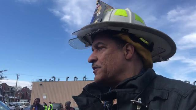 Detroit Fire Chief Michael Jefferson speaks to media about the apartment fire on Woodward Avenue and Woodland Street on Saturday in Detroit, and assured residents that a nearby fire hydrant was working.