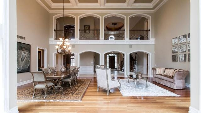 This lavish home in Bloomfield Township is a showplace for the list of luxury elements popular for traditional-style houses built here in the last 20 years.