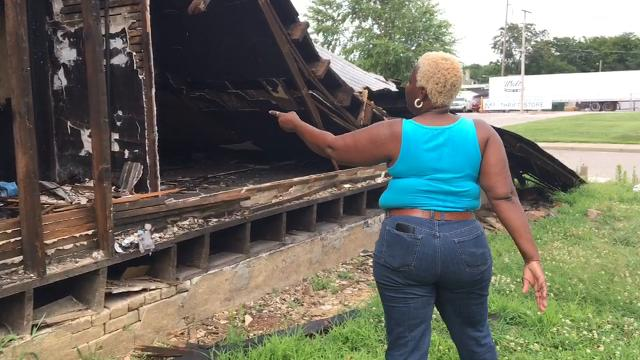 The city demanded a home owner on Evansville's southside demolish her fire damaged house, and to the dismay of her neighbors, the woman is attempting to take the house down herself. It's a slow process.