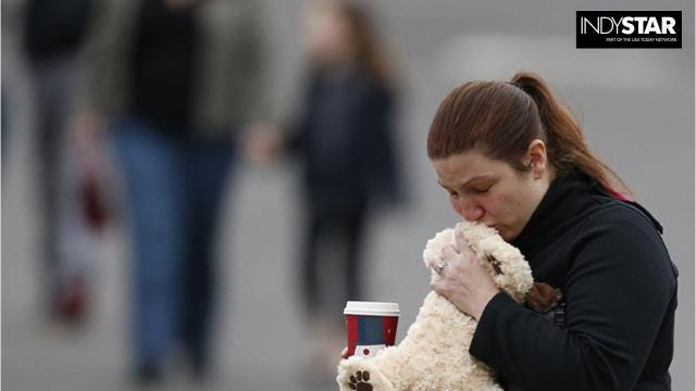 Veterinarian Jody Sandler received an award in Indianapolis from the American Veterinary Medical Association. He volunteered his organization's therapy dogs to help Sandy Hook Elementary School families cope with their grief.
