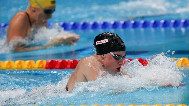 Lilly King sets world record in 100-meter breaststroke