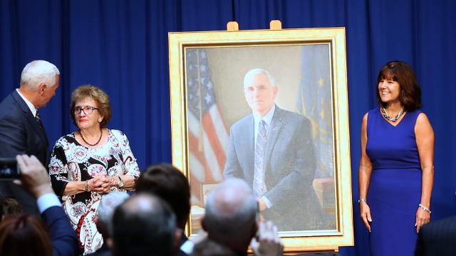 Vice President Mike Pence is joined by family and supporters as his Indiana Gubernatorial portrait is unveiled at the Indiana Statehouse.