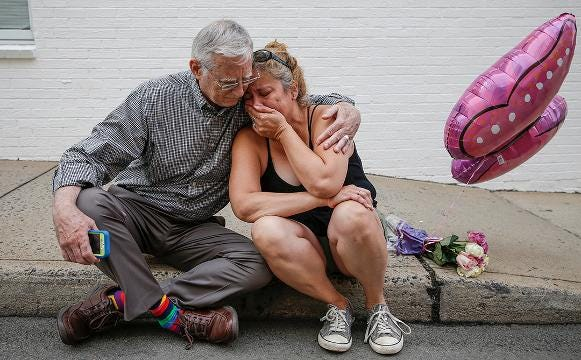 Residents of Charlottesville mourn a day after violent 'Unite the Right' rally
