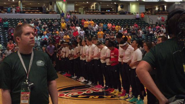 The Indiana Fever take part in a moment of silence for Heather Heyer, who was killed eight days earlier in Charlottesville, Va.