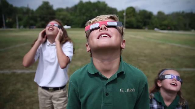People of all ages made their way outside to watch the solar eclipse in Indianapolis on Monday, August 21, 2017.