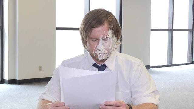 "A Jon Webb column gets a dramatic reading. And by ""dramatic,"" we mean he gets hit in the face with pie. How many pies? You'll have to watch."