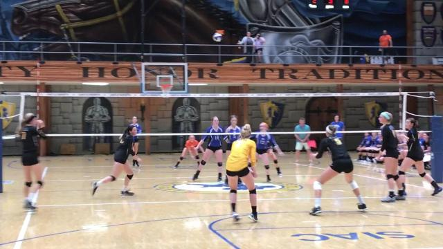 Castle volleyball defeats Memorial in four sets