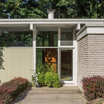 A mid-century modern home designed by Evans Woollen III on the market for $475,000.