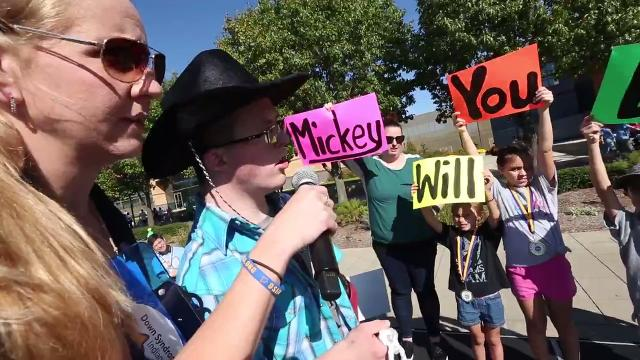 At the Buddy Walk, Peter Sima asks Mickey Deputy to prom.  What does she say?