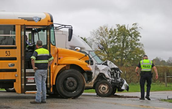 An R.T. Moore Plumbing Heating and Air Conditioning truck collided with a School bus carrying children from the Blue Academy in Decatur Township at the intersection of Ralston Rd. and  Paddock Rd. on Monday, Oct. 23, 2017.