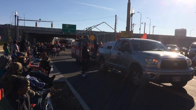 Megan Fakih describes why her family decided to attend the Evansville Christmas Parade on North Main Street Sunday afternoon.