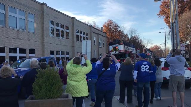 The Memorial Tigers football team returned to school for a final celebration of their first state championship in school history.