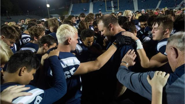 A national advocacy group says Reitz football coach Andy Hape's prayer with his team broke constitutional religious laws.