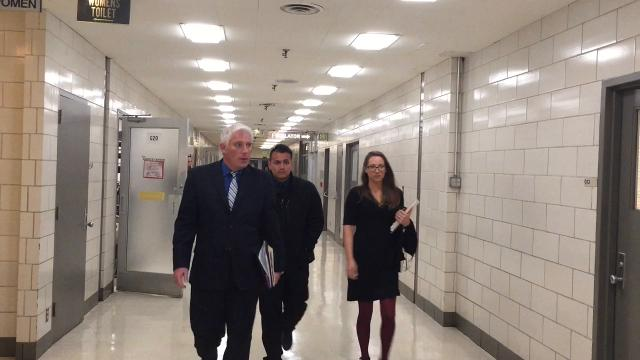 Raw video: IMPD Officer Francisco Olmos arrives for a Dec. 1, 2017, court hearing on accusations he deleted messages on the cellphone of an 18-year-old woman who committed suicide two years ago.