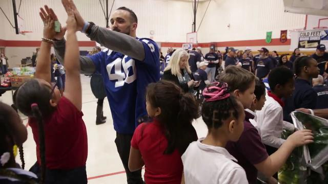 Students from IPS School #63 had a chance to meet a few Colts players, cheerleaders, and mascot Blue at an event co-sponsored by Lids to get shoes and warm hats to these west side kids, Indianapolis, Tuesday, Dec. 5, 2017.