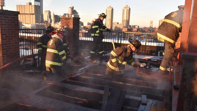 Indianapolis firefighters on Friday morning, Dec. 8, 2017, battled a fire that gave off billowing smoke but appeared to be contained to the roof of a Downtown Indianapolis building.