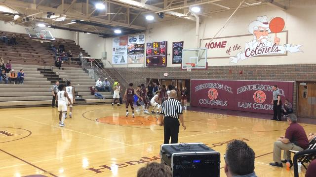 Henderson County's Kale Gaither drives in to attempt a game-winning shot. Henderson County coach Tyler Smithhart is called for a technical foul after the play because there was no foul called on Gaither's shot or the rebound by Dada Simpson