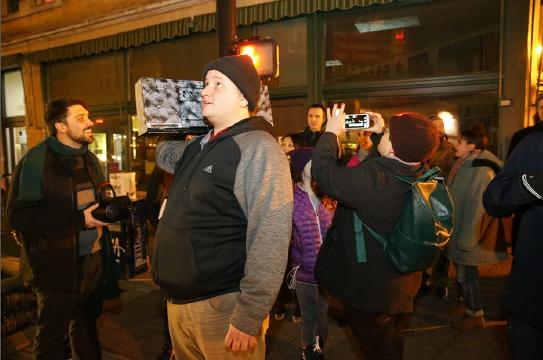 """Forward Motion musical ensemble brings """"Unsilent Night"""" boom box electronic music caroling to Fountain Square on Saturday, Dec. 16, 2017."""