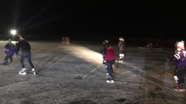 A local hockey team took its practice outdoors for the first time, to a frozen pond in Elberfeld.