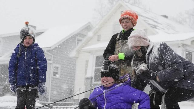 Kids take full advantage of the first snow day of 2018 at Reitz Hill.