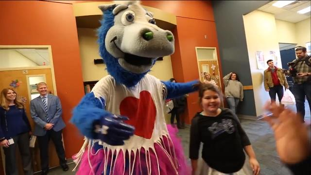 Indianapolis Colts mascot Blue delivers Valentines, donuts, and hugs to Damar Charter Academy.
