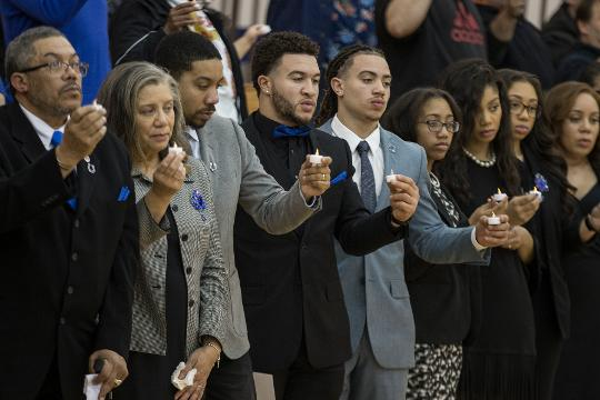 A vigil is held to remember late Indianapolis Colts player Edwin Jackson and Uber driver Jeffrey Monroe, at Guion Creek Middke School in Indianapolis, Feb. 15, 2018. Jackson and Monroe were killed by a suspected drunk driver on Feb. 4, 2018.
