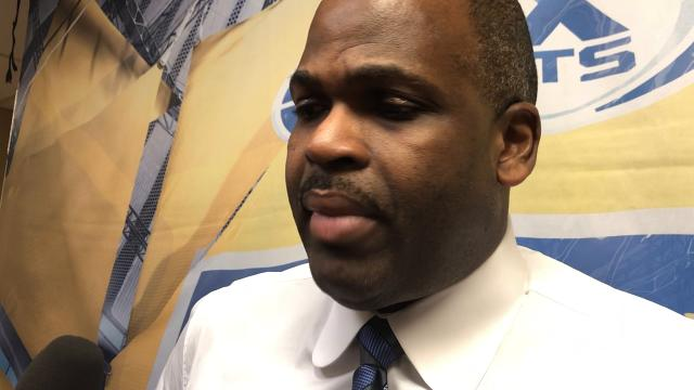 Pacers coach Nate McMillan caps a win over the Sixers