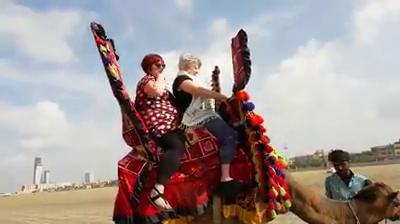 C&P content coach rides a camel in Pakistan.