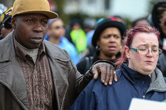 """More than one hundred walked the streets on the east side, Saturday, March 31, for """"Let's March for Malaysia"""" led by Ten Point Coalition, encouraging an end to gun violence in Indianapolis after 1-year-old Malaysia Robson was fatally shot."""