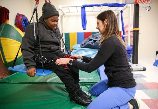 Ty-Juan Preer, 11, was paralyzed by a bullet in a drive-by shooting three years ago in Indianapolis. Ty is determined to walk again and eventually play football. Physical therapist Sarah Johnson talks about his progress at Riley Children's Hospital.