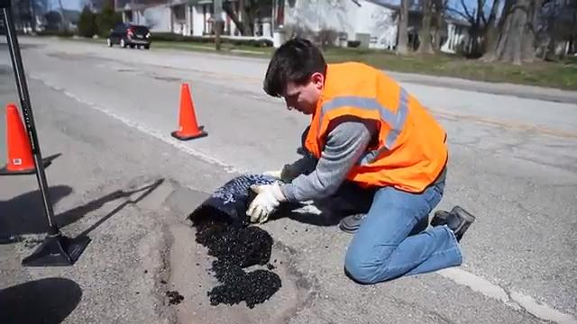 Mike Warren and Chris Lang created Open Source Roads, a grassroots organization aiming to repair Indiana's pothole-riddled roads. They buy materials at hardware stores, gather friends to volunteer and patch holes on Indy's worst side streets.