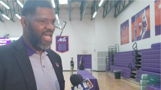"Evansville basketball head coach Walter McCarty talks about his newest assistants, Todd Lickliter and Matthew Graves, on Friday at the annual ""Lunch with the Aces"" event."