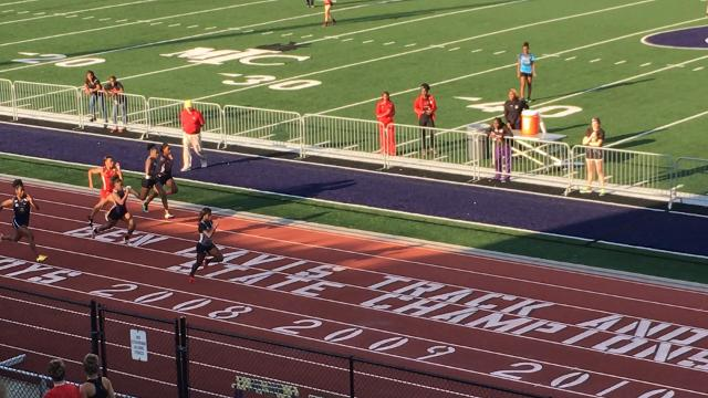 Brebeuf Jesuit's Semira Killebrew wins the 100 meters in a regional track and field meet at Ben Davis.