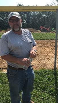 Brad Cederberg, foreman of the crew renovating the baseball, field, notices the attention local residents are giving the project.