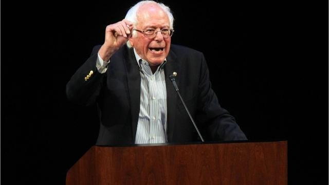 Sen. Bernie Sanders (I-Vt.) drew over 1,700 people to Hanhcer Auditorium for a book reading in Iowa City Thursday night. A group of protesters also used the event to protest the democratic socialist politician.