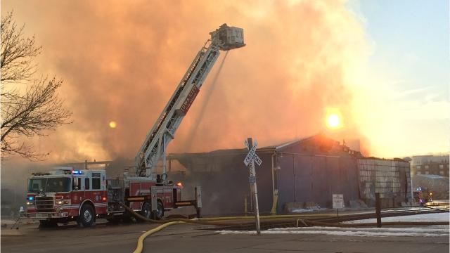 A warehouse on the southern edge of downtown Iowa City was engulfed in flames Friday afternoon, and firefighters were still working to put out the blaze as the sun set.