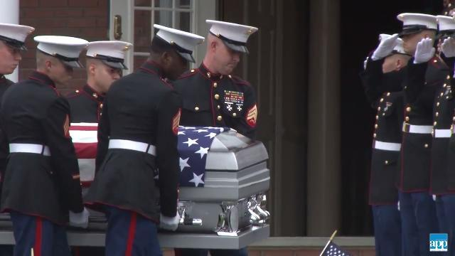 Crowds gather to pay tribute to fallen marine