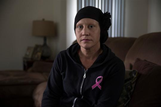 Cancer patient allegedly told to remove headscarf for license photo