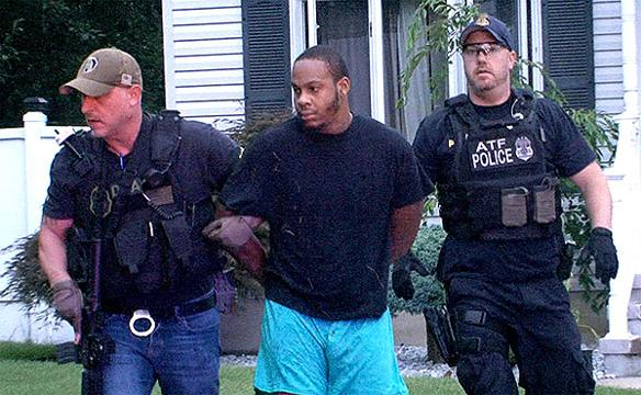 Agents arrest James F. Smith III, aka 'Brim Reaper,' at his family's Manchester home.  He is one of 12 people charged in a drug trafficking organization that distributed large quantities of heroin at the Shore.  STAFF VIDEO BY THOMAS P. COSTELLO