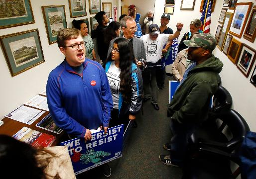 Immigrant rights organizations chant list of demands in the Morristown Congressional district office of Rodney Frelinghuysen.