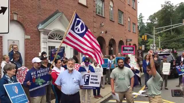 Groups rally outside Rep. Rodney Frelinghuysen's office in Morristown. 9/6/17