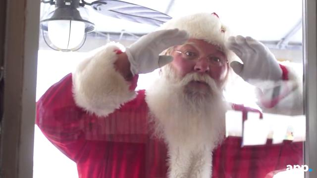 Santa takes time out of his busy schedule to talk to kids at Klein's in Belmar.