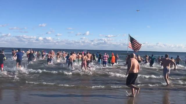 Hundreds from all over New Jersey braved the frigid temperatures to either plunge into frigid ocean water or support those taking the icy dip at the 2018 Sons of Ireland New Year's Day Polar Bear Plunge at the Asbury Park Convention Hall.
