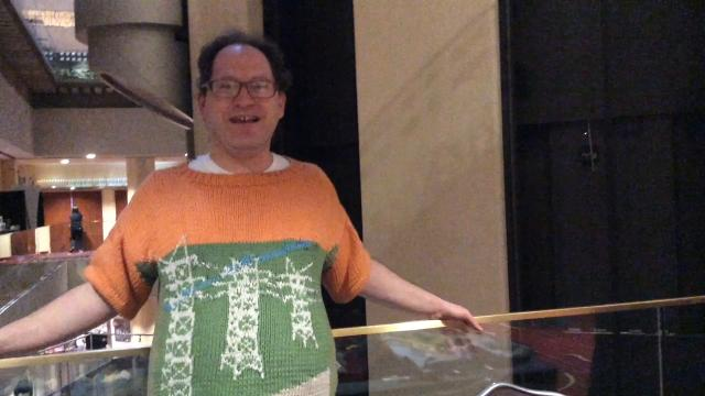 Sweater designer Sam Barsky knits intarsia pictures of places he's visited. He's been to 33 countries and often poses for photos wearing sweaters of the places he's visiting.
