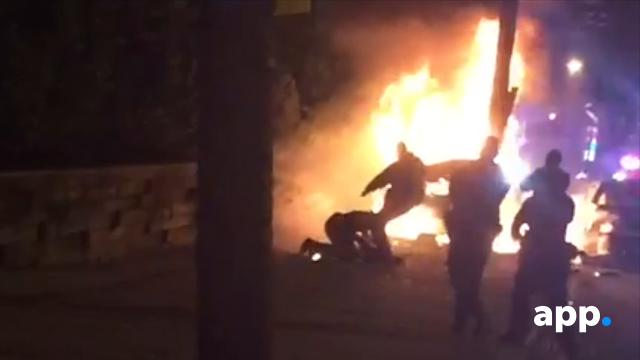 Police misconduct: Police kick burning crash victim