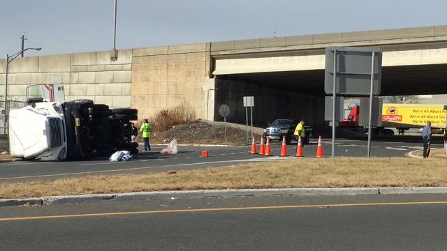 A tractor trailer flipped while driving through the Somerville Circle on Wednesday.
