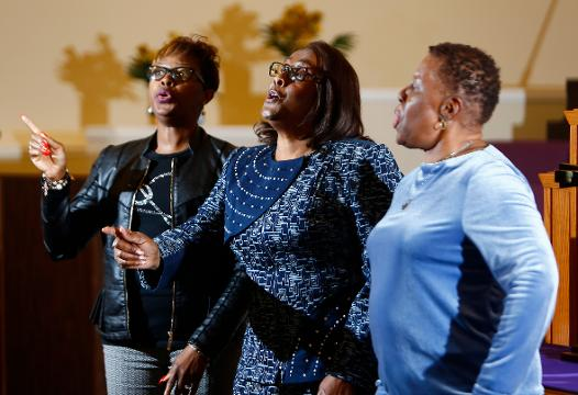Renowned gospel singers, The Lumzy Sisters of Mississippi sing 'We are depending on you' at Mount Calvary Missionary Church in New Brunswick.