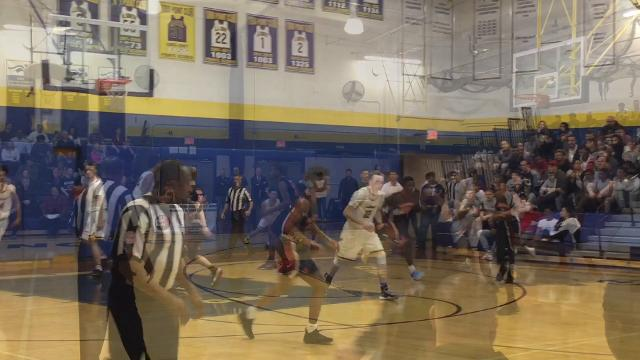 The seventh-seeded Colonia boys basketball team advanced to the GMC Tournament quarterfinals with a 51-35 win over No. 10 Woodbridge on Feb. 15, 2018.