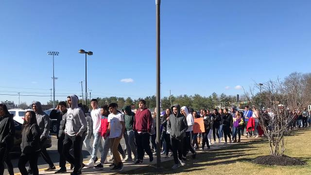 Students at Monroe High School walking out of class Wednesday morning as part of a nationwide student protest calling for gun control in the wake of the Parkland school shooting one month ago.
